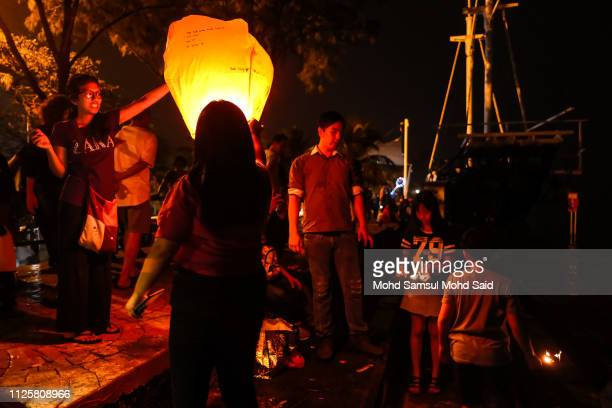 People burn flying lanterns near the North port during Chap Goh Meh celebrations to mark the end of Chinese New Year of the Pig on February 19 2019...