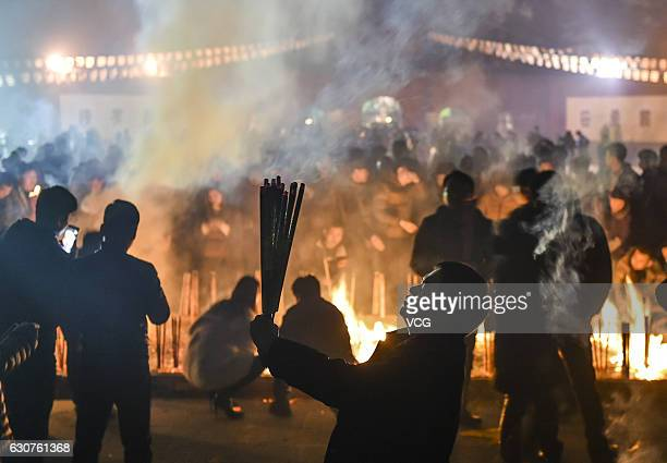 People burn incense to pray for a lucky new year at White Horse Temple on December 31 2016 in Luoyang Henan Province of China Nearly ten thousand...