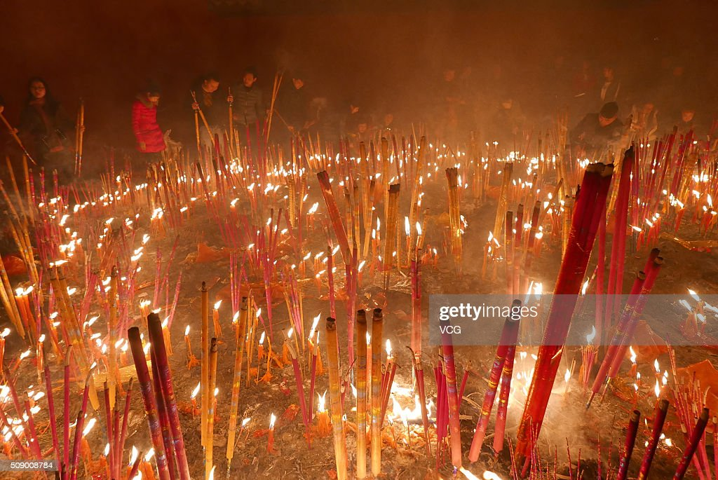 People burn incense to pray for good luck and fortune at a