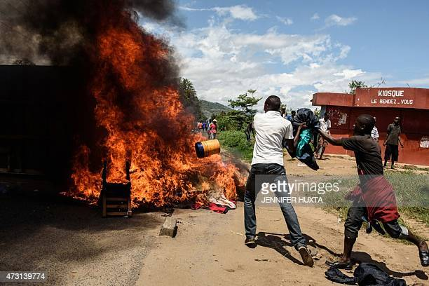 People burn mattresses looted from the local police post on 13 May in Musaga neighborhood in Bujumbura during a protest against incumbent president...