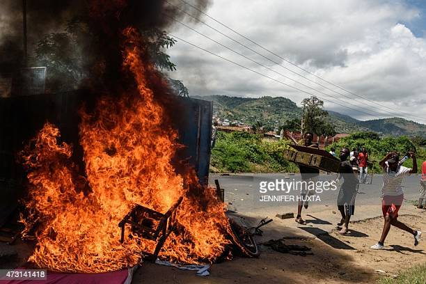 People burn mattresses looted from the local police post on 13 May 2015 in Musaga neighborhood in Bujumbura during a protest against incumbent...