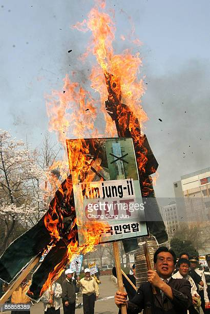 People burn portraits of North Korean leader Kim JongIl during a protest against North Korea on April 8 2009 in Seoul South Korea Protests in South...
