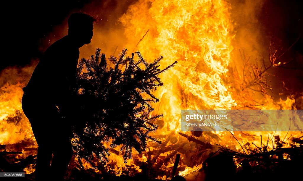 topshot people burn their christmas trees on the museum square on january 3