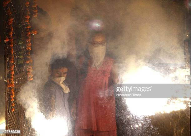 People bursting crackers as they celebrate the Diwali the festival of Light on October 23 2014 in New Delhi India Diwali the festival of lights was...