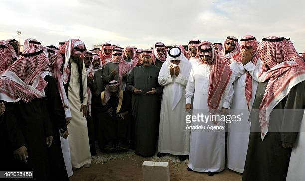 People bury the late Saudi King Abdullah bin Abdulaziz alSaud at Al Oud cemetery in Riyadh Saudi Arabia on January 23 2015
