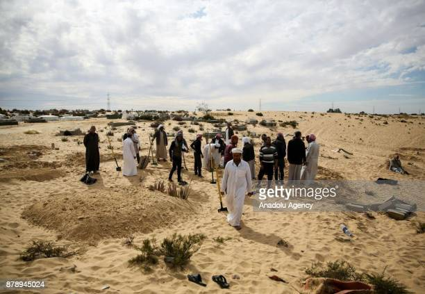 People bury victims of the of the Egypt Sinai mosque bombing in AlArish Egypt on November 25 2017 The death toll in the attack on a mosque in Egypts...