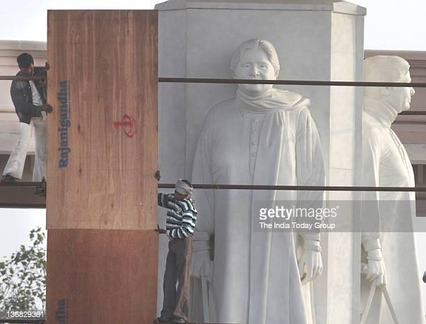 People busy in covering up statues of Uttar Pradesh Chief Minister Mayawati and of elephants the BSP symbol in Noida to comply with the Election...