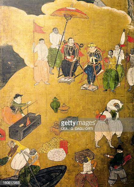 People busy trading detail from The Portuguese arriving in Japan paper screen Japan Nanban Civilization