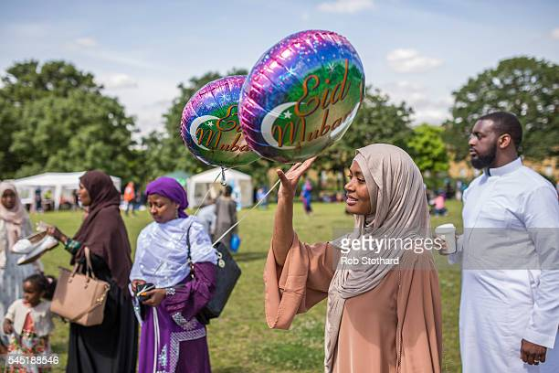 People buy balloons as they celebrate the festival of Eid at Southwark Eid Festival in Burgess Park on July 6 2016 in London England Thousands...