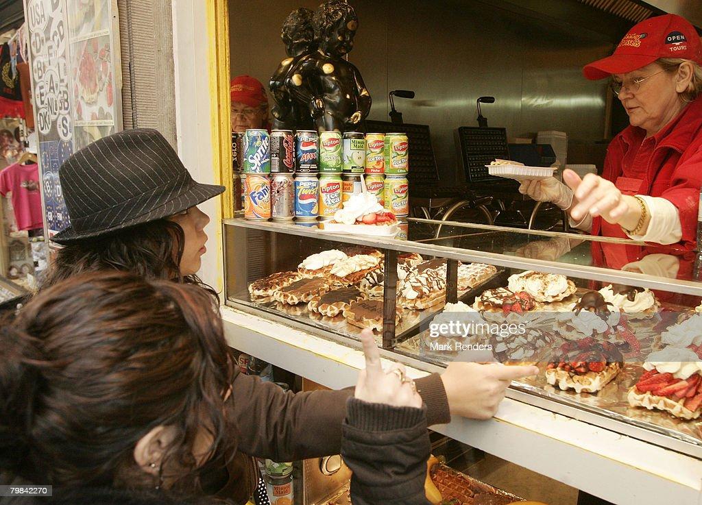 People buy Belgian waffles near la Grande Place on February 19, 2008 in Brussels, Belgium.