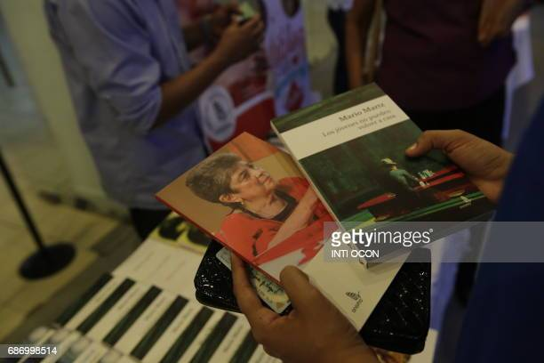 People buy books of writer Claribel Alegria winner of award Reina Sofia of Poetry during the fifth literary festival CentroAmérica Cuenta dedicated...