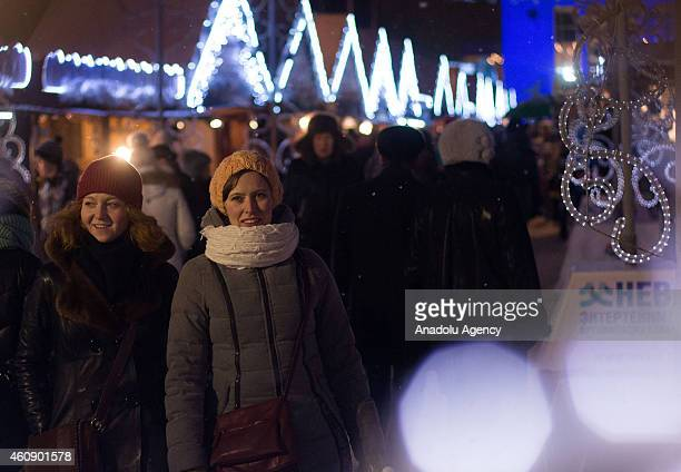 People buy Christmas gift from stalls set up during Christmas fair in Saint Petersburg Russia on December 282014