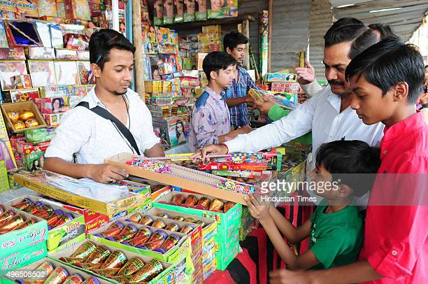 People buy crackers of Diwali on November 10 2015 in Bhopal India Festival of light Diwali is one of the most important festivals of India celebrated...
