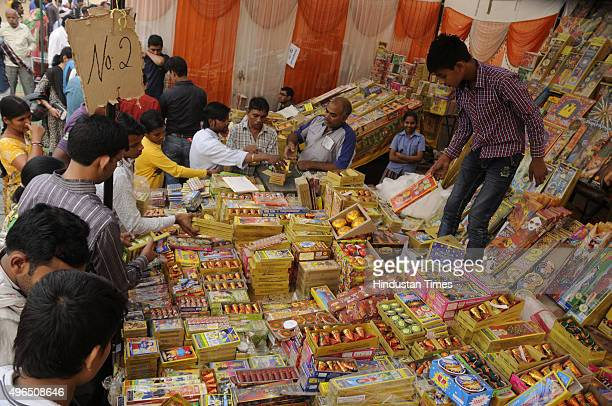 People buy crackers of Diwali on November 10 2015 in Gurgaon India Festival of light Diwali is one of the most important festivals of India...
