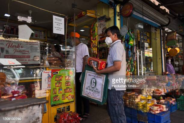 People buy essentials from a grocery store on day eleven of the 21day nationwide lockdown to curb the spread of coronavirus at Krishna Market Kalkaji...