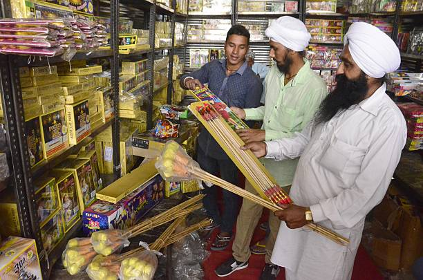 People buy fireworks and crackers ahead of Diwali festival at crackers market at New Amritsar on October 29 2016 in Amritsar India Diwali is one of...