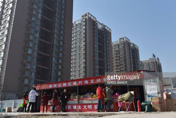 People buy fireworks at a stall on the outskirts of Beijing in the buildup to Lunar New Year celebrations on February 13 2018 Beijing has banned...