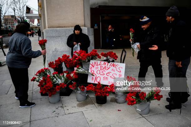 People buy flowers after work near a Metro station on Valentines Day in Washington DC on February 14 2019