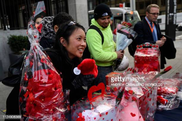 People buy flowers and gifts after work near a Metro station on Valentines Day in Washington DC on February 14 2019