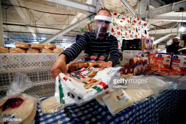 People buy food at a market in Algiers Algeria on April 24 2020 In the Islamic holy month of Ramadan