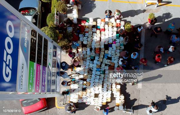 People buy gasoline at a gas station in Morelia Michoacan state one of several Mexican states where shortages have been reported on January 8 2019...
