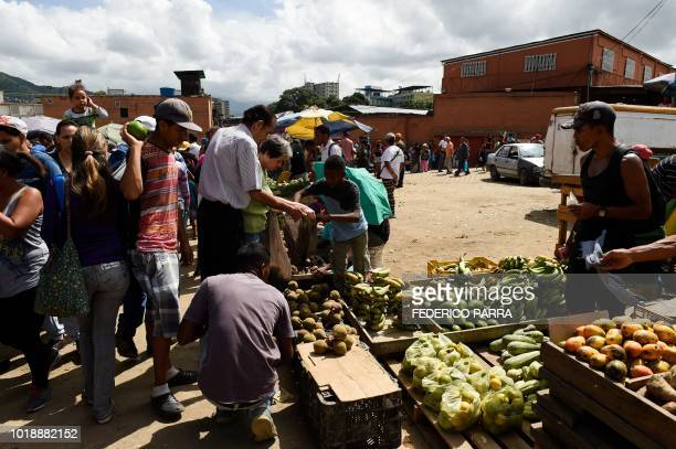 People buy groceries at the municipal market of Coche a neighbourhood of Caracas on August 18 2018 ahead of Monday when Venezuela will start issuing...