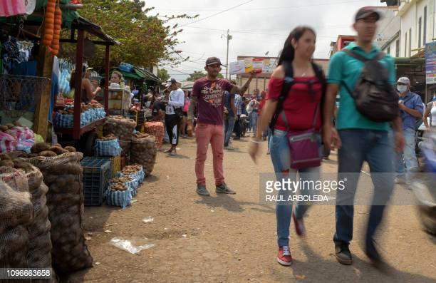 People buy groceries in the La Parada neighborhood in Cucuta Colombia near the Simon Bolivar International Bridge on the border with Tachira...
