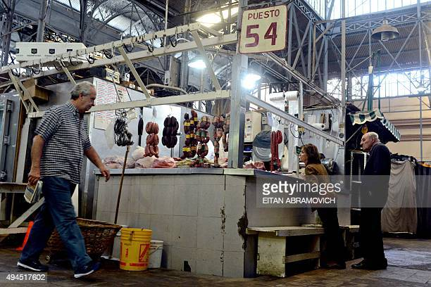 People buy meat at a market in Buenos Aires on October 27 2015 Sausages ham and other processed meats cause bowel cancer and red meat probably does...