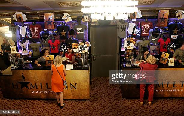 People buy merchandise before a special performance of the Broadway musical Hamilton at the Richard Rodgers Theatre on July 12 2016 in New York City...