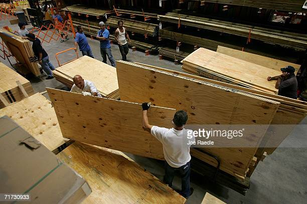 People buy plywood at a Home Depot store as they prepare to cover their windows in preparation for the approaching Tropical Storm Ernesto that is...