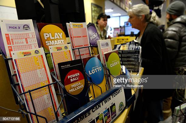People buy Powerball lottery tickets in hopes of winning the $15 billion jackpot at Safeway on January 12 2016 in Estes Park Colorado The Powerball...
