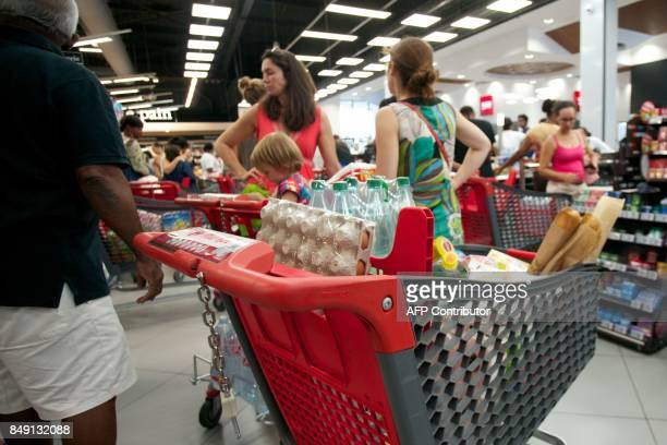 People buy provisions on September 18 in PetitBourg on the Fench Caribbean island of Guadeloupe as Hurricane Maria approaches the Caribbean Hurricane...