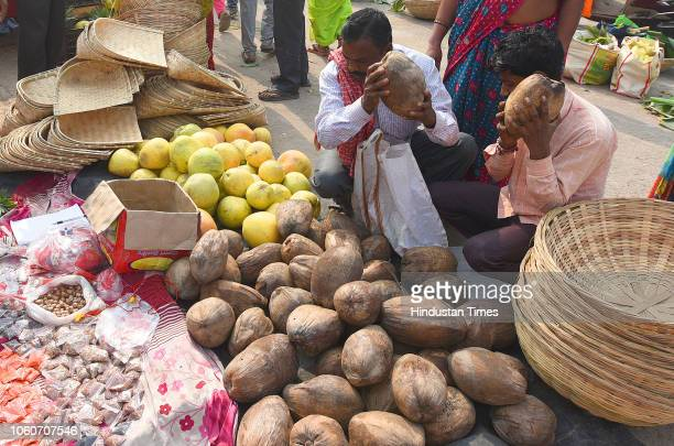 People buy puja ingredients for the upcoming Chhath Puja at Geeta Colony on November 12 2018 in New Delhi India The Goddess who is worshipped during...