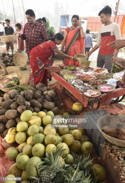 People buy puja ingredients for the upcoming Chhath Puja at Geeta Colony on November 1 2019 in New Delhi India The Goddess who is worshipped during...