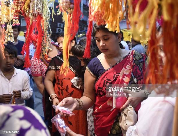People buy rakhi on the eve of Raksha Bandhan festival at Karol Bagh Market on August 6 2017 in New Delhi India Raksha Bandhan or simply Rakhi is a...