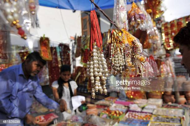 People buy ritual things from a roadside shop a day before the Navratri festival starts at Sector 27 market on March 30 2014 in Noida India Navratri...
