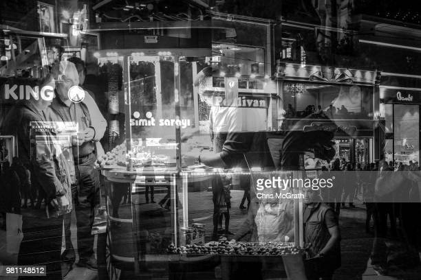 People buy roasted chestnuts on Istiklal street on April 23 2018 in Istanbul Turkey With Turkey being just days away from the most important...