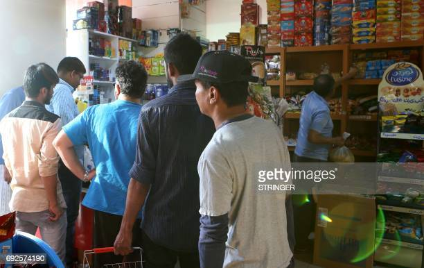 People buy snacks at a shop in Doha on June 5 2017 Saudi Arabia also closed its borders with Qatar effectively blocking food and other supplies...