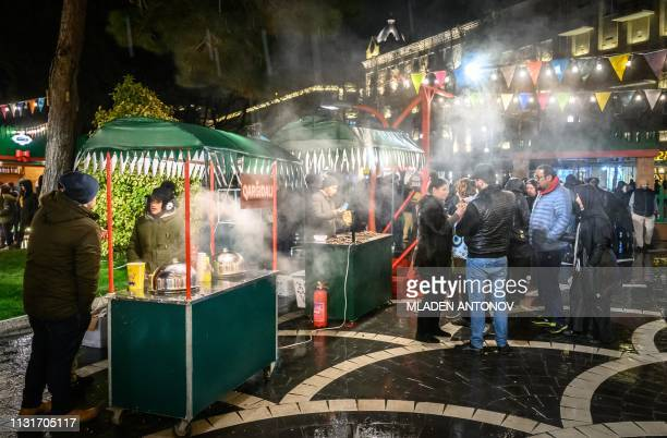 People buy traditional sweets at a Nowruz holiday market in Baku on March 20 2019 Nowruz marks the first day of spring and the beginning of the year...