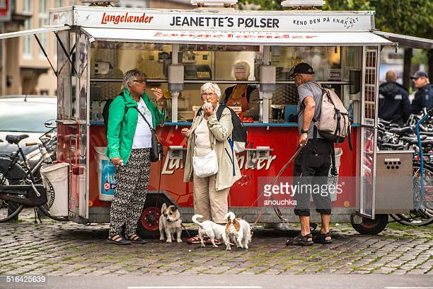 people buying and eating snacks in copenhagen, denmark - danish culture stock pictures, royalty-free photos & images