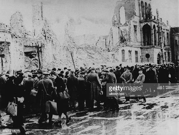 People buying and selling at the black market in the ruins at Leipziger Strasse in East Berlin