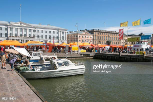 people buying and selling patatoe by market square helsinki finland