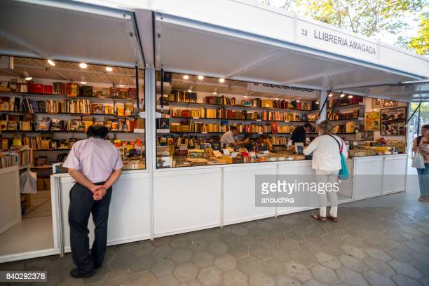 People buying books on Passeig de Gracia, shopping street in Barcelona, Spain