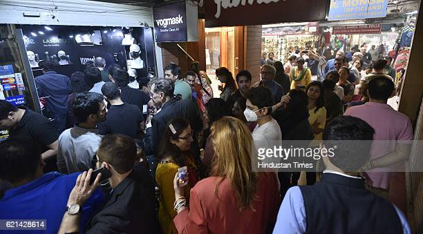 People buying breathe clean air masks at Khan Market for protection against pollution as smog covers the capital's skyline on November 6 2016 in New...