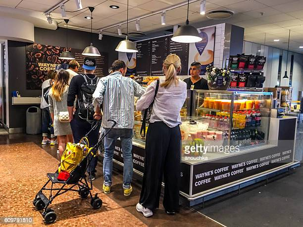 People buying coffee and snacks at Arlanda Airport, Stockholm, S
