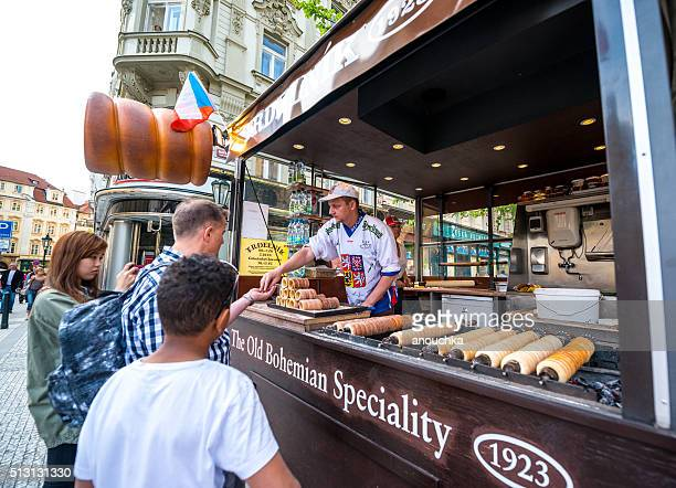 People buying famous Trdelnik in Prague