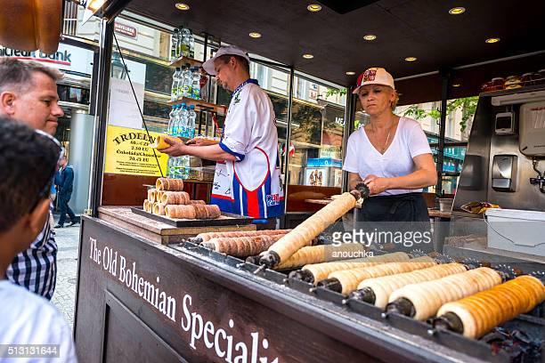 People buying famous Trdelnik in Prague