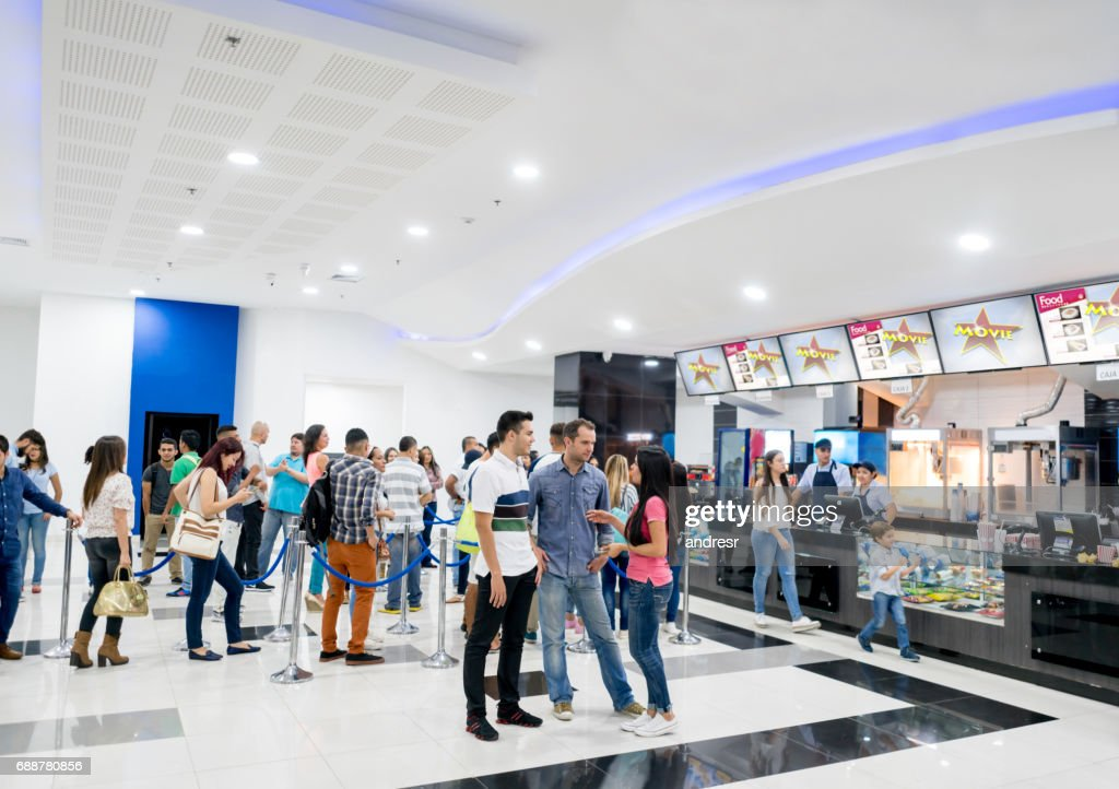 People buying food at the cinema before watching a movie : Stock Photo