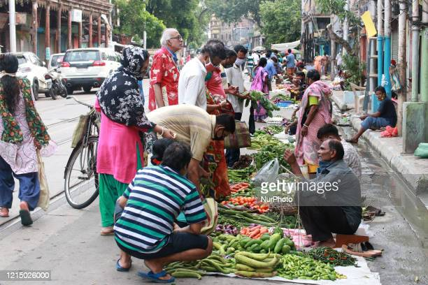 People buying fresh organic vegetables on a temporary vegetables Market on a Street after the government eased a lockdown imposed as a preventive...