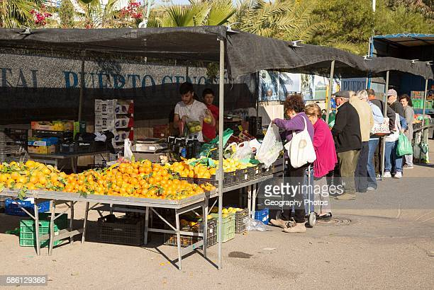 People buying fruit and vegetables at market stall San Jose Almeria Spain